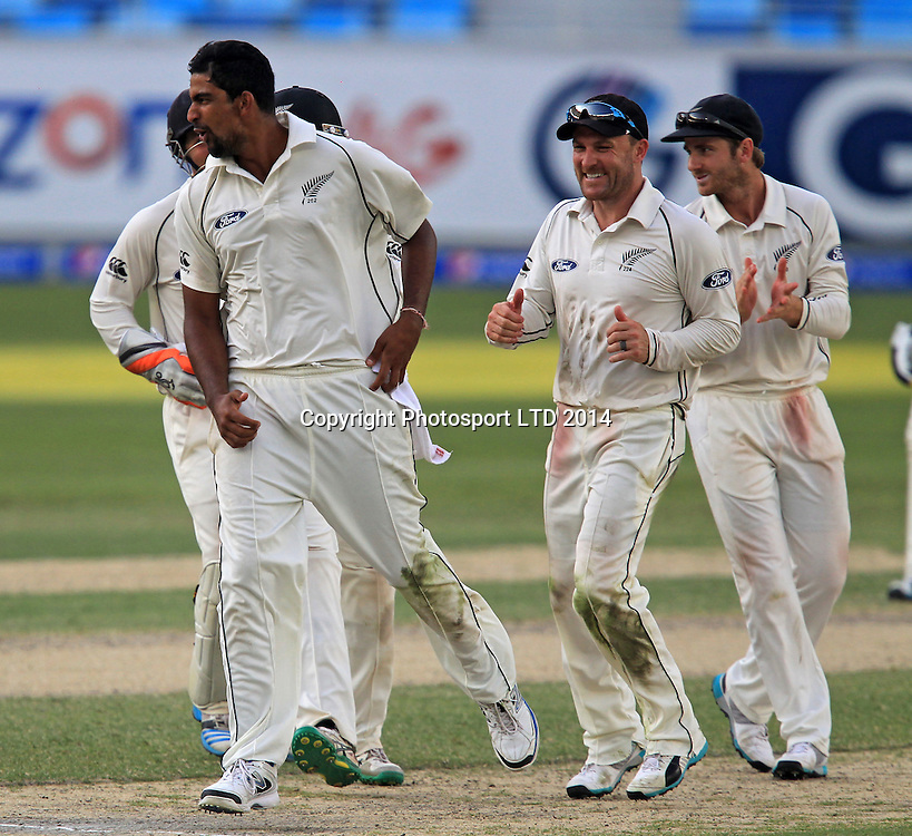Pakistan vs New Zealand, 19 November 2014 <br /> Ish Sodhi celebrates with team mates after taking the wicket of Azhar Ali on the third day of second test in Dubai