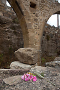 "Flowers left beside an aquaduct in the ancient Hellenic city of Polyrinia, Crete. The place name means ""many sheep"" and it was the most fortified city in ancient Crete."