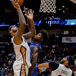 Oct 30, 2017; New Orleans, LA, USA; New Orleans Pelicans forward DeMarcus Cousins (0) is defended by Orlando Magic forward Jonathan Isaac (1) during the second half of a game at the Smoothie King Center. Mandatory Credit: Derick E. Hingle-USA TODAY Sports