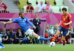 (R) Spain's Cesc Fabregas (nr10) fights for the ball with Italy's Daniele De Rossi (nr16) during their the UEFA EURO 2012 Group C football match between Spain and Italy at Gdansk Arena in Gdansk on June 10, 2012...Poland, Gdansk, June 10, 2012..Picture also available in RAW (NEF) or TIFF format on special request...For editorial use only. Any commercial or promotional use requires permission...Photo by © Adam Nurkiewicz / Mediasport