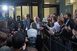 Labour Leader Jeremy Corbyn is swamped in a media scrum and cheered by supporters after his 18-14 vote victory at Labour HQ in Victoria Street as the party's National Executive Committee met to rule in a secret vote on whether Mr Corbyn should automatically be included in the party's leadership ballot, triggered by ex-shadow business secretary Ms Eagle's leadership challenge.