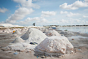 Workers labour on the salt extraction at the Lac Rose near Dakar, Senegal, on Tuesday, July 26, 2016. *** Second Sentence *** Photographer: Xaume Olleros/Bloomberg