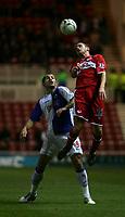 Photo: Andrew Unwin.<br /> Middlesbrough v Blackburn Rovers. Carling Cup. 21/12/2005.<br /> Middlesbrough's Matthew Bates (R) outjumps Blackburn's Shefki Kuqi (L).