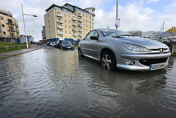 © Licensed to London News Pictures. 03/01/2018. Newhaven, UK.  Sea water breaching the flood defences near luxury flats in Newhaven Marina, East Sussex, as a spring tide coincides with the effects of Storm Eleanor.  Photo credit: Peter Cripps/LNP