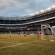 David Villa, NYCFC, has a shot well saved by Bobby Shuttleworth, New England Revolution, with the backdrop of Yankee Stadium during the New York City FC v New England Revolution, inaugural MSL football match at Yankee Stadium, The Bronx, New York,  USA. 15th March 2015. Photo Tim Clayton