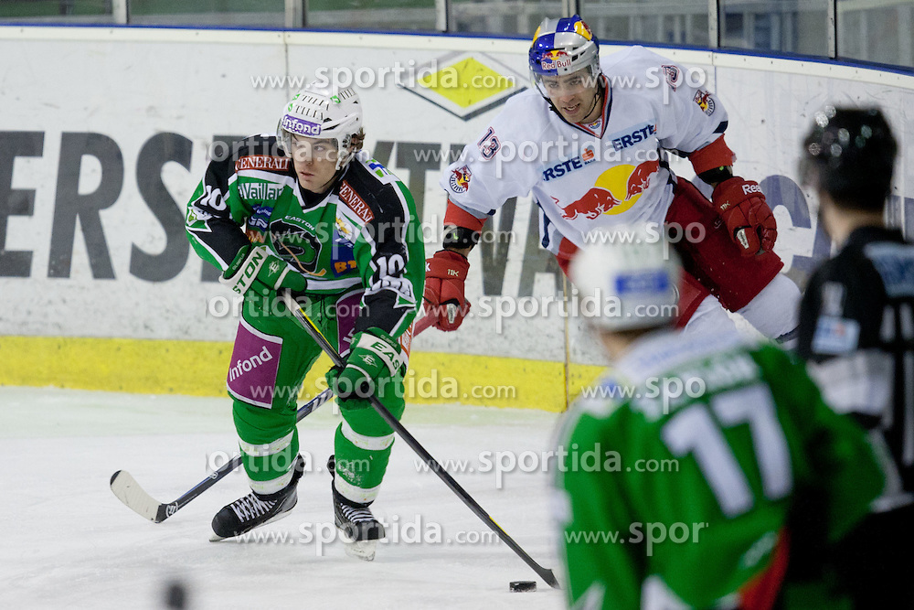 Brock McBride (HDD Tilia Olimpija, #10) and Michael Schiechl (EC Red Bull Salzburg, #13) during ice-hockey match between HDD Tilia Olimpija and EC Red Bull Salzburg in 48th Round of EBEL league, on January 29, 2012 at Hala Tivoli, Ljubljana, Slovenia. (Photo By Matic Klansek Velej / Sportida)