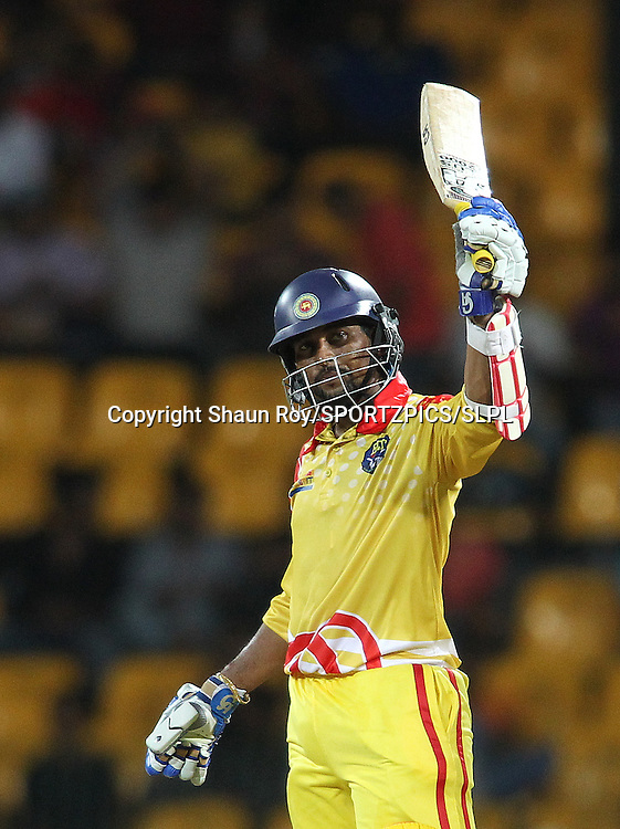 Basnahira Cricket Dundee captain Tillakaratne Dilshan raises his bat after reaching his fifty during match 4 of the Sri Lankan Premier League between Uva Next and Basnahira Dundee held at the Premadasa Stadium in Colombo, Sri Lanka on the 12th August 2012<br />  <br /> Photo by Shaun Roy/SPORTZPICS/SLPL