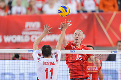 14.09.2014, Luczniczka Hall, Bydgoszcz, POL, FIVB WM, Polen vs Frankreich, 2. Runde, Gruppe E, im Bild Fabian Drzyzga, Kevin Le Roux // during the FIVB Volleyball Men's World Championships 2nd Round Pool F Match beween Poland and France at the Luczniczka Hall in Bydgoszcz, Poland on 2014/09/14. EXPA Pictures © 2014, PhotoCredit: EXPA/ Newspix/ Mariusz Palczynski<br /> <br /> *****ATTENTION - for AUT, SLO, CRO, SRB, BIH, MAZ, TUR, SUI, SWE only*****