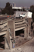 Aftermath of the October 17, 1989 Loma Prieta Earthquake in Oakland, California. The highest concentration of fatalities, 42, occurred in the collapse of the Cypress Street Viaduct on the Nimitz Freeway (Interstate 880), where a double-decker portion of the freeway collapsed, crushing the cars on the lower deck. At a magnitude of 7.1, it was the worst earthquake in the San Francisco Bay Area since 1906.