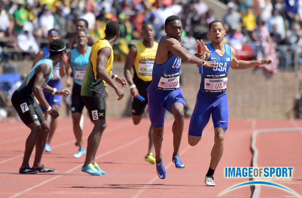 Apr 28, 2018; Philadelphia, PA, USA; Mike Berry aka Michael Berry takes the handoff from Marcus Chambers on the anchor leg of the USA Red 4 x 400m relay that won the USA vs. The World race in 3:01.31 during the 124th Penn Relays at Franklin Field.