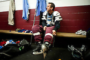 Former Minnesota Gov. Tim Pawlenty, and GOP presidential candidate, laces up his skates to play hockey in Des Moines, Iowa, July 22, 2011.