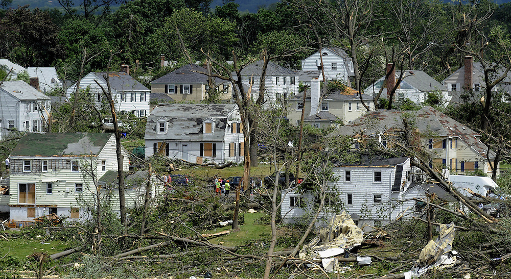 Homes are damaged in a neighborhood a day after a tornado in Springfield, Mass.  Nearly 40,000 people are still without power following a string of tornadoes that ripped through central and western Massachusetts. (AP Photo/Jessica Hill)
