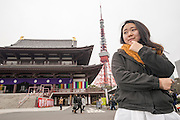 A young Japanese lady at Zojo-ji Temple, near Tokyo Tower.