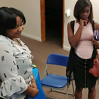Aberdeen School District Family and Community Engagement Coordinator Sheraton Crosby helps a potential adult education student during an Aberdeen Parent Center open house last week.