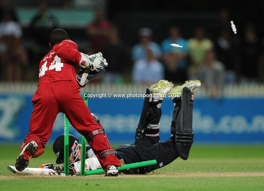 Kane Williamson just makes his ground as Tatenda Taibu takes the bails off during the 2nd Twenty20 InternationaI cricket match between New Zealand and Zimbabwe at Seddon Park in Hamilton, New Zealand on Tuesday 14 February 2012. Photo: Andrew Cornaga/Photosport.co.nz