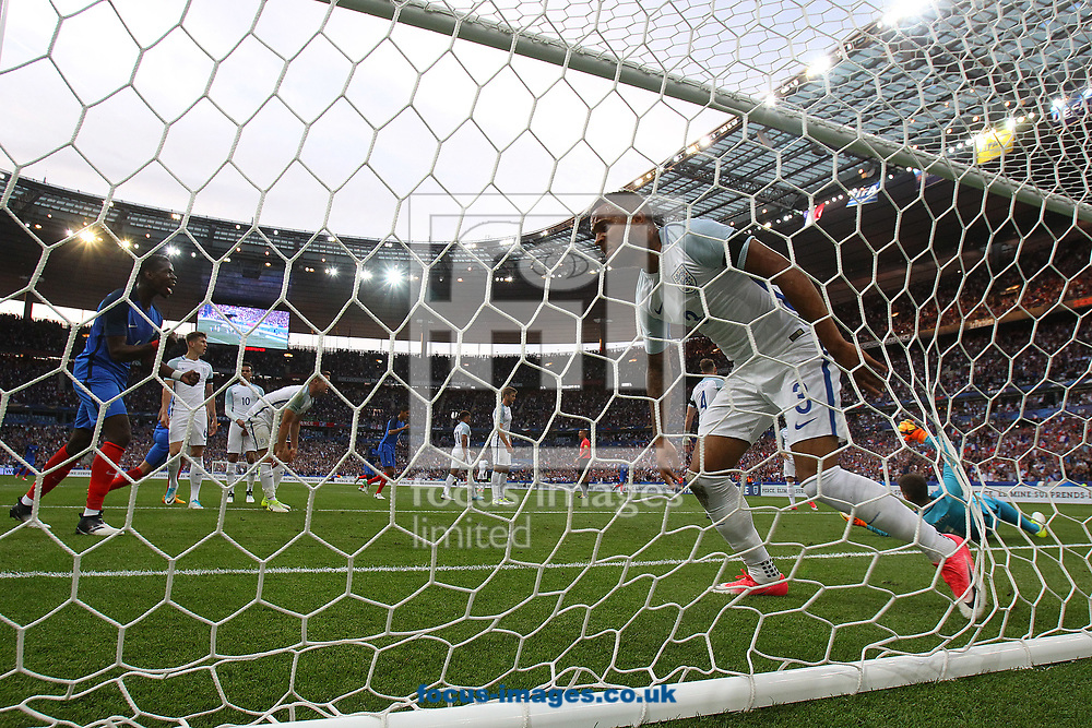 Ryan Bertrand of England looks dejected as Paul Pogba of France celebrates his side&rsquo;s 1st goal during the International Friendly match at Stade de France, Paris<br /> Picture by Paul Chesterton/Focus Images Ltd +44 7904 640267<br /> 13/06/2017