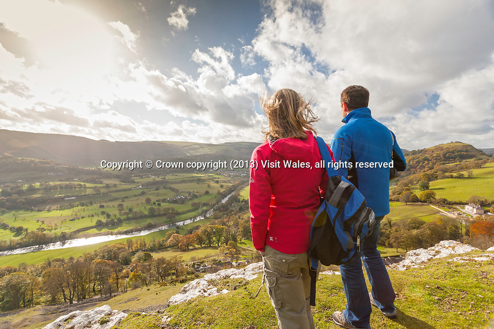 Couple walking on Offa's Dyke Path, overlooking the Vale of Llangollen<br /> Denbighshire<br /> North<br /> Walking<br /> Activities and Sports