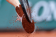 Paris, France - 2017 June 03: Agnieszka Radwanska from Poland cleans her shoes during women's single match third round  during tennis Grand Slam tournament The French Open 2017 (also called Roland Garros) at Stade Roland Garros on June 03, 2017 in Paris, France.<br /> <br /> Mandatory credit:<br /> Photo by &copy; Adam Nurkiewicz<br /> <br /> Adam Nurkiewicz declares that he has no rights to the image of people at the photographs of his authorship.<br /> <br /> Picture also available in RAW (NEF) or TIFF format on special request.<br /> <br /> Any editorial, commercial or promotional use requires written permission from the author of image.