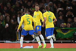 Brazil's Neymar (centre) celebrates scoring his side's first goal of the game from the penalty spot with team mates during the International Friendly match at the Emirates Stadium, London.