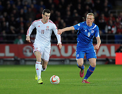 Gareth Bale of Wales (Real Madrid) is chased down by Kolbeinn Sigthorsson (Ajax) of Iceland - Photo mandatory by-line: Dougie Allward/JMP - Tel: Mobile: 07966 386802 03/03/2014 -