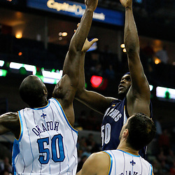 Jan 20, 2010; New Orleans, LA, USA; Memphis Grizzlies forward Zach Randolph (50) shoots over New Orleans Hornets center Emeka Okafor (50) during the first half at the New Orleans Arena. Mandatory Credit: Derick E. Hingle-US PRESSWIRE