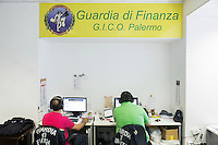 """PALERMO, ITALY - 6 JUNE 2016: Marshals of the Guardia di Finanza (Financial Police) are here in the interception room of the GICO (Gruppo Investigativo Criminalità Organizzata), as they listen to live interceptions and wiretaps in the headquarters of the Guardia di Finanza (Financial Police) in Palermo, Italy, on June 6th 2016.<br /> <br /> Between January 2014 e December 2015 more than 120 tons of hashish, carried on fishing boats or cargo ships from Morocco to Libya, were seized in the Strait of Sicily by Italy's Guardia di Finanza (Financial Police) thanks to an international police investigation named """"Operazione Libeccio"""", carried out by the GICO (Gruppo Investigativo Criminalità Organizzata, Organised Crime Investigation Group), a unit of the tax police of Palermo under the supervision of the DDA (Direzione Distrettuale Antimafia) of Palermo.<br /> <br /> """"What is happening in Libya is same historical occurrence that happened years ago in Afghanistan. Such as the Talibans who financed their terroristic activities with heroin trafficking for the purchase of weapons, the Caliphate is proposing the same terroristic strategy by purchasing and commercialising hashish in order to purchase weapons used in their war"""" Sergio Barbera, Deputy General Prosecutor of Palermo, said."""