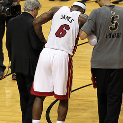 Jun 19, 2012; Miami, FL, USA; Miami Heat small forward LeBron James (6) is helped off the court after an injury during the fourth quarter in game four in the 2012 NBA Finals against the Oklahoma City Thunder at the American Airlines Arena. Mandatory Credit: Derick E. Hingle-US PRESSWIRE