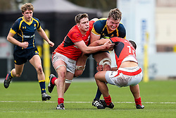 Ted Hill (Worcester Sixth Form College) (capt) of Worcester Warriors U18 is tackled by Manu Vunipola of Saracens U18 - Rogan Thomson/JMP - 16/02/2017 - RUGBY UNION - Sixways Stadium - Worcester, England - Worcester Warriors U18 v Saracens U18 - Premiership Rugby Under 18 Academy Finals Day 5th Place Play-Off.
