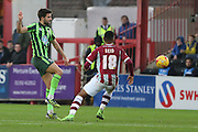 George Francomb of AFC Wimbledon gets there before Jamie Reid of Exeter City during the Sky Bet League 2 match between Exeter City and AFC Wimbledon at St James' Park, Exeter, England on 28 December 2015. Photo by Stuart Butcher.