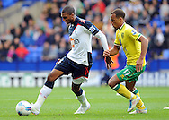 Picture by Chris Donnelly/Focus Images Ltd. 07500 903009 .17/9/11.David NGog of Bolton and Elliot Bennet of Norwich during the Barclays Premier League match at Reebok stadium, Bolton.