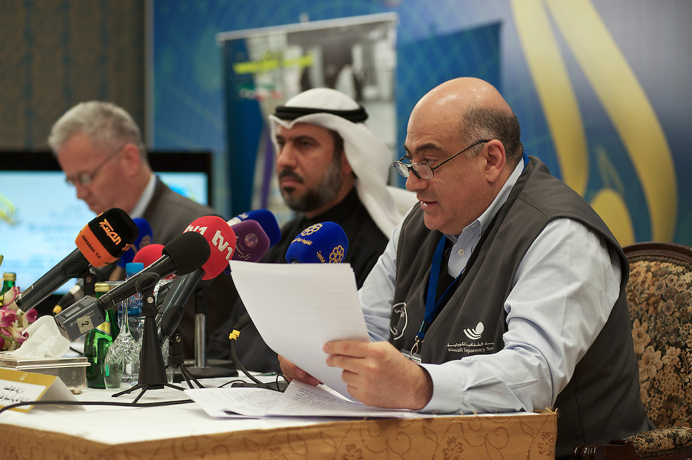 Arab Network for Election Democracy representatives Ziad Abdel Samad (Right) and Taleb Awad (left) and Salah Al Ghazali address a news conference on the parliamentary elections in Kuwait City, February 3, 2012. Kuwaiti voters chose among 285 candidates running for the new 50-seat assembly.