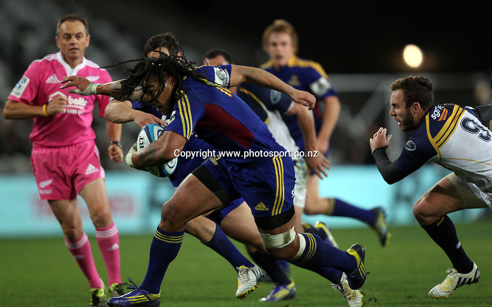 Ma'a Nonu of the Highlanders makes a break.<br /> Super Rugby - Highlanders v Brumbies, 12 April 2013, Forsyth Barr Stadium, Dunedin, New Zealand.<br /> Photo: Rob Jefferies / photosport.co.nz
