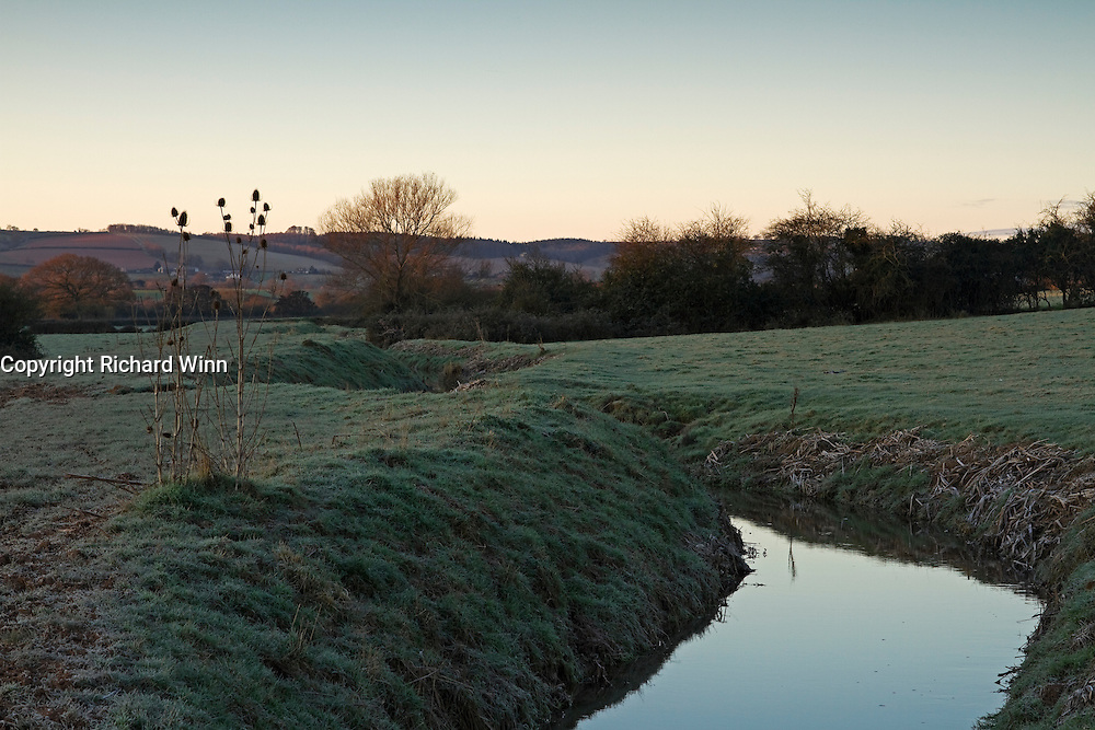 A pre-dawn view of Durleigh Brook on the edge of The Meads near Bridgwter, Somerset on a frosty December morning.