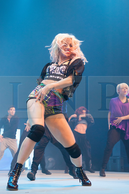 "© Licensed to London News Pictures. 09/03/2012. London, England. Kimberly Wyatt, ""Got to Dance""-Judge and former ""Pussycat Doll"" performs at the UK's biggest dance event ""Move It"" at London Olympia on 9 March with dancers from D.inc. Photo credit: Bettina Strenske/LNP"