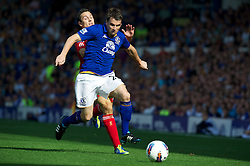 LIVERPOOL, ENGLAND - Saturday, October 1, 2011: Liverpool's Stewart Downing in action against Everton's Seamus Coleman during the Premiership match at Goodison Park. (Pic by David Rawcliffe/Propaganda)