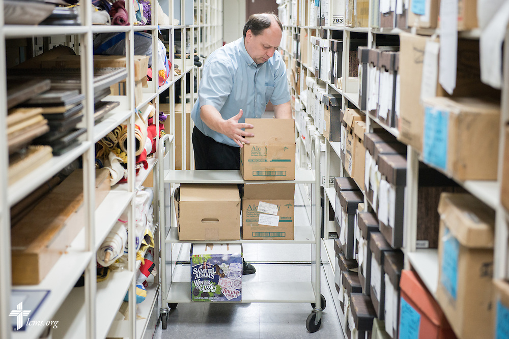 The Rev. Todd Zittlow stacks items on the shelves of the archive Monday, July 21, 2014, at Concordia Historical Institute on the campus of Concordia Seminary in Clayton, Mo.  LCMS Communications/Erik M. Lunsford