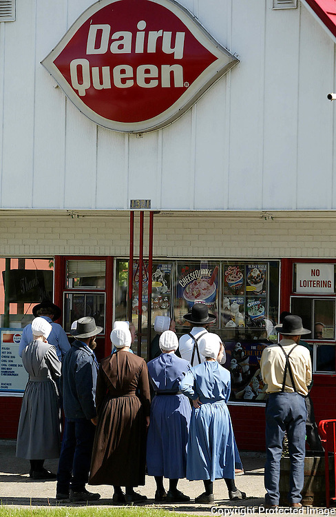 dairy queen - des moines, may 3 --There's something about a sunny spring day that kicks up the yen for ice cream.  Tuesday a group of Mennonites came to the big city to order treats at Dairy Queen on University Ave. in Des Moines.  photo by david peterson