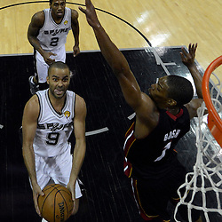 Jun 13, 2013; San Antonio, TX, USA; San Antonio Spurs point guard Tony Parker (9) shoots against Miami Heat center Chris Bosh (1) during the second half of game four of the 2013 NBA Finals at the AT&T Center. The Miami Heat defeated the San Antonio Spurs 109-93. Mandatory Credit: Derick E. Hingle-USA TODAY Sports