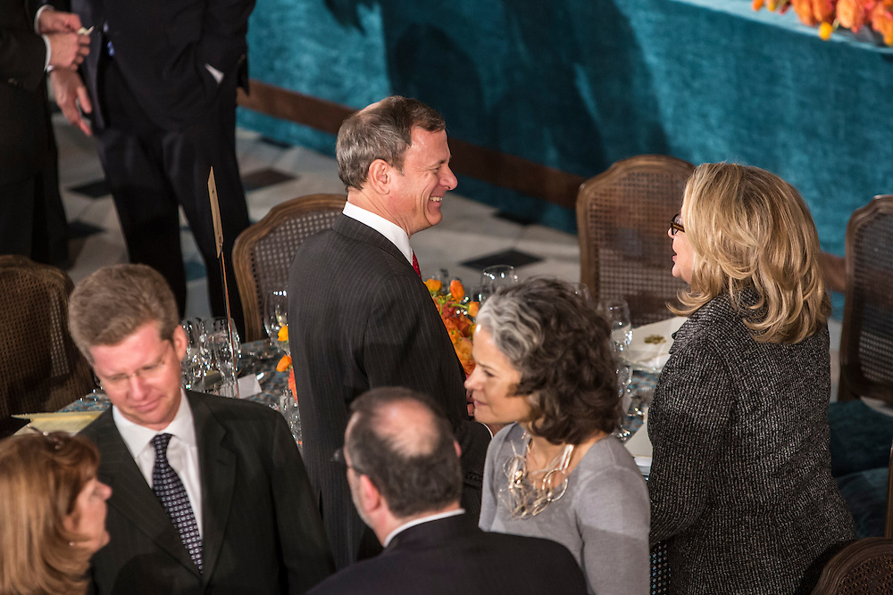 Supreme Court Justice John Roberts talks with Secretary of State Hillary Clinton at the Inaugural Luncheon in Statuary Hall of the U.S. Capitol on Monday, January 21, 2013 in Washington, DC.
