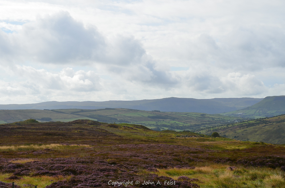 A long view over the heather fields into the valleys below in County Antrim, Northern Ireland