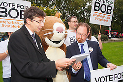 "Nature campaigners accompanied by a  giant red squirrel, Bob, urge MPs to ""Vote For Bob"" during a photocall outside Parliament. Their aim is to get MPs to support nature in Britain. PICTURED:  Julian Hupert, right, MP receives a petitionfrom Vote for Bob nature campaigners."