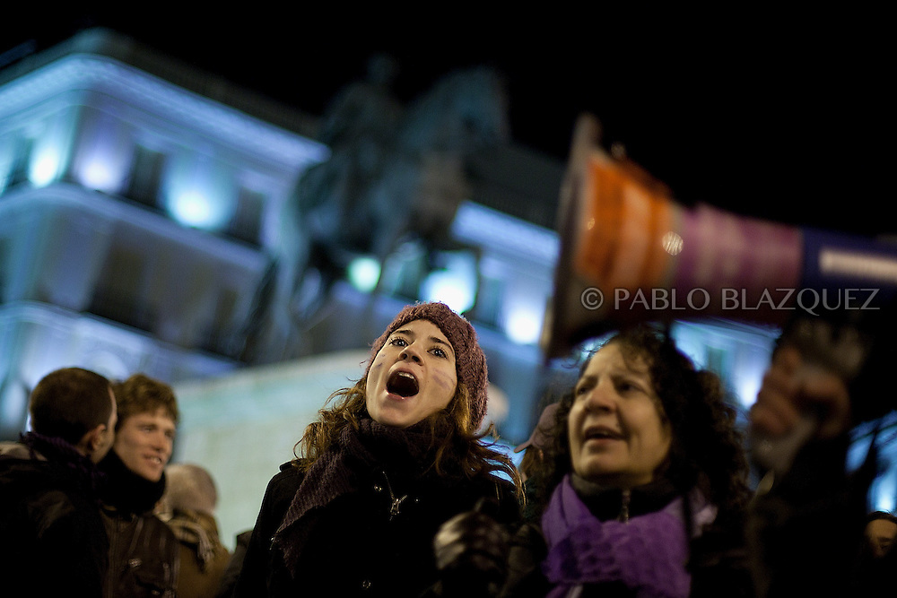 Women attend the violet movement demonstration to protest against social cuts in equality and law reforms on abortion while another demonstration organized by Spain's 'indignant' protesters takes place at the Puerta del Sol square in Madrid on February 10, 2012, hours after Spain's right-leaning government unveiled a labour reform. The number of jobless people in Spain shot above five million at the end of 2011, sending the unemployment rate to 22.85 percent -- double the European average and the highest in the industrialized world. Placard read 'Wether you are priest or imam, equality for women!'