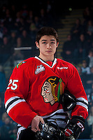 KELOWNA, CANADA - JANUARY 21: Evan Weinger #25 of the Portland Winterhawks stands on the blue line during the national anthem against the Kelowna Rockets on January 21, 2017 at Prospera Place in Kelowna, British Columbia, Canada.  (Photo by Marissa Baecker/Shoot the Breeze)  *** Local Caption ***