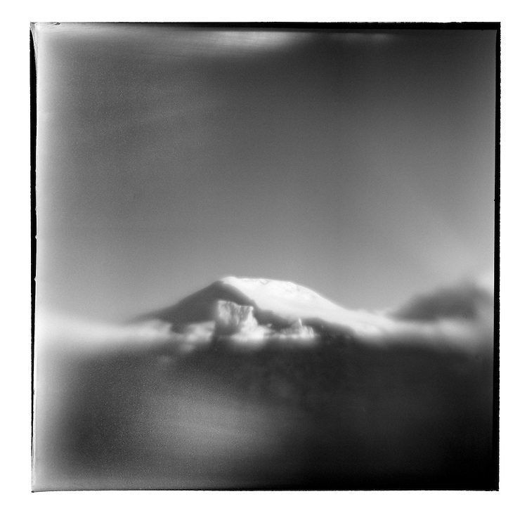 Antarctica, Blurred black and white image of icebergs floating along Antarctic Peninsula on sunny summer afternoon