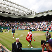 LONDON, ENGLAND - JULY 13:  Venus Williams of the United States and Johanna Konta of Great Britain enter Center Court for the Ladies Singles Semi Final match during the Wimbledon Lawn Tennis Championships at the All England Lawn Tennis and Croquet Club at Wimbledon on July 13, 2017 in London, England. (Photo by Tim Clayton/Corbis via Getty Images)