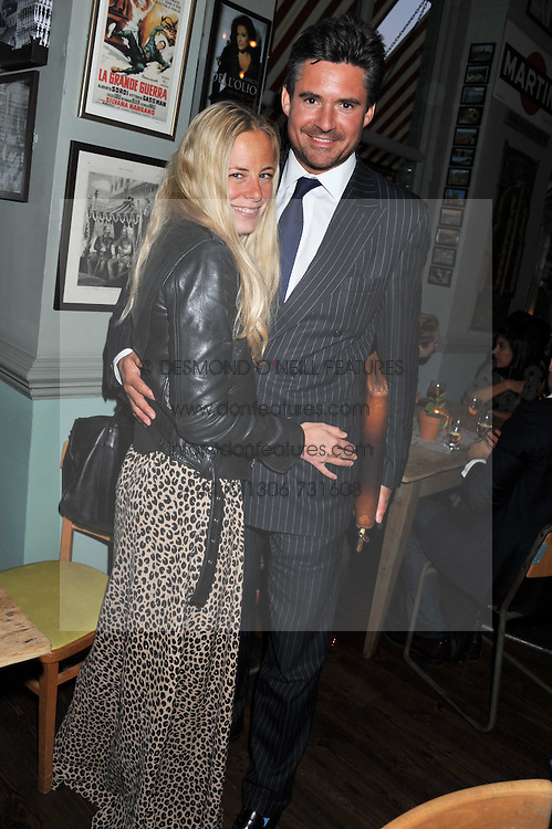 ASTRID HARBORD and EDWARD TAYLOR at a party to celebrate the opening of Bunga Bunga - a new Pizzeria & Bar, 37 Battersea Bridge Road, London SW11 on 1st September 2011.