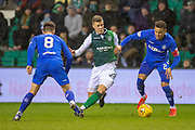 Florian Kamberi (#22) of Hibernian FC runs between Ryan Jack (#8) and James Tavernier (#2) of Rangers FC during the Ladbrokes Scottish Premiership match between Hibernian and Rangers at Easter Road, Edinburgh, Scotland on 8 March 2019.