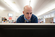 Matt Townsley, Director of Instruction and Technology at Solon Community Schools in Solon, Iowa, checks on computers at Solon High School on Tuesday, March 8, 2016.