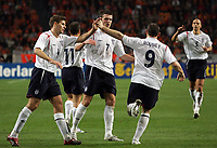 Photo: Paul Thomas.<br /> Holland v England. International Friendly. 15/11/2006.<br /> <br /> England and Wayne Rooney (9) celebrate his goal.