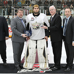 TRENTON, - Apr 15, 2016 -  Ontario Junior Hockey League game action between Trenton Golden Hawks and the Georgetown Raiders. Game 1 of the Buckland Cup Championship Series. At the Duncan Memorial Gardens, ON. 2015-2016 OJHL Awards presentation for Top Goaltender of the year Daniel Urbani. Presented by OJHL Chairman of the Board of Governors Scott McCrory. Gary Moroney Vice Chairman of the Board Ontario Hockey Association and<br />  OJHL Commissioner Marty Savoy.<br /> (Photo by Tim Bates / OJHL Images)